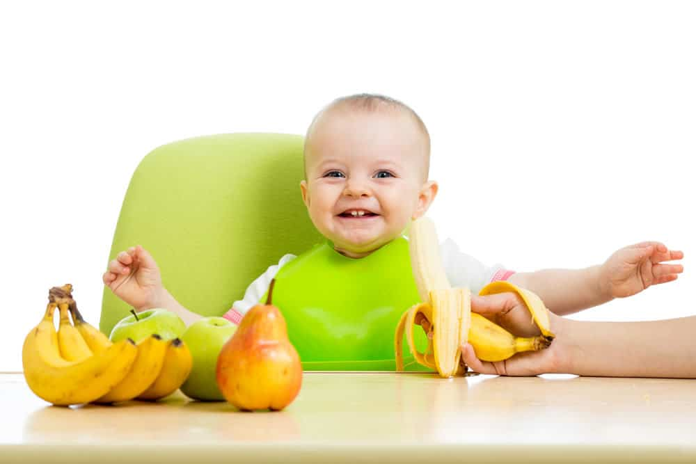 Image result for baby eating fruit