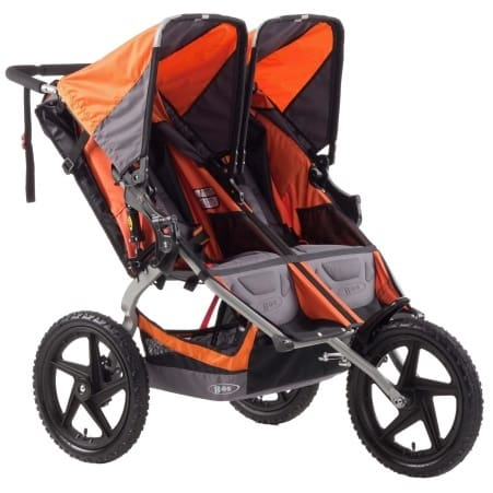 A side by side stroller that allows your baby to play with each other as you jog in the park. - Best Triple Jogging Stroller Review   Baby Journey