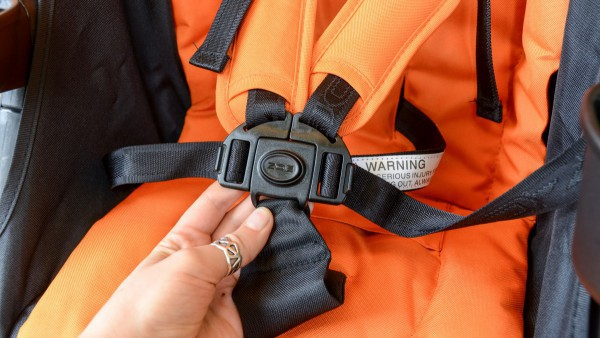 The 5-point harness ensure your baby safety sitting in the stroller. - Zoe Umbrella XL1 Single Stroller Review | Baby Journey