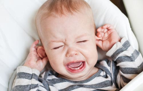 Excessive ear pulling and crying can be a sign of an ear infection. - A Guide on Baby Fussing When Breastfeeding | Baby Journey