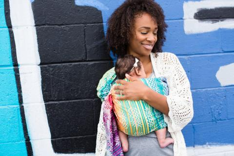 Mom wearing her baby in a rainbow ring sling. - 5 Best Baby Carrier for Hot Weather | Babyjourney