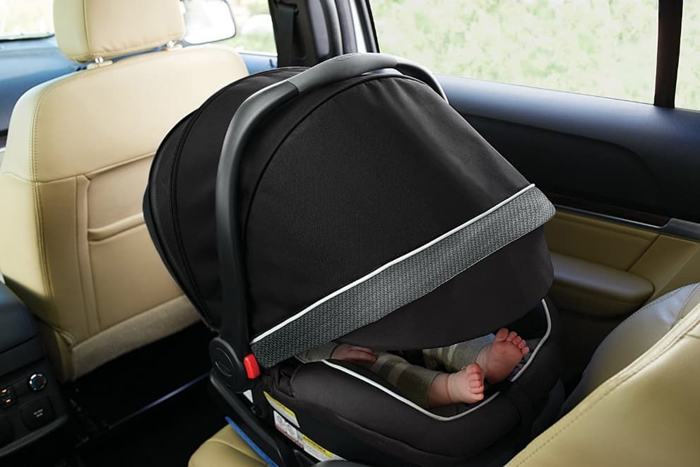 Full-coverage canopy on the SnugRide Elite keeps baby protected from the sun and prying eyes (Source: CARiD)