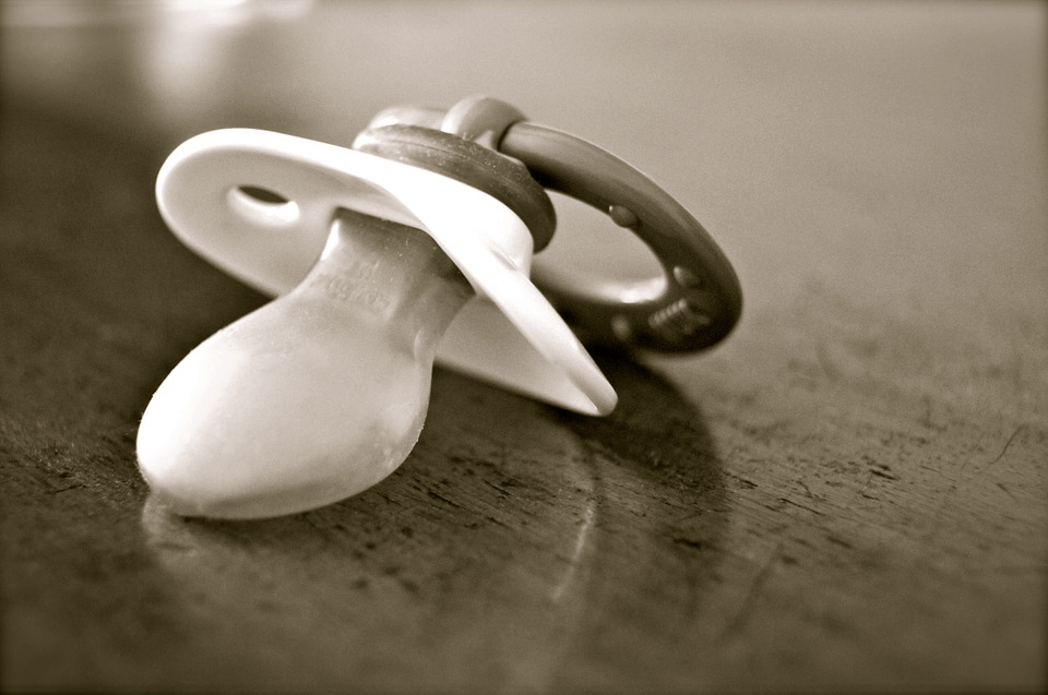A small pacifier made from soft silicone for added comfort.
