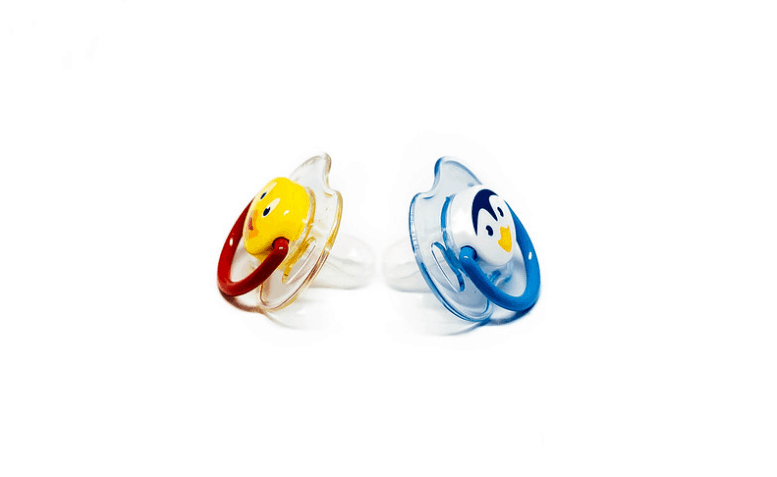 Two small pacifiers which are ideal for young babies.