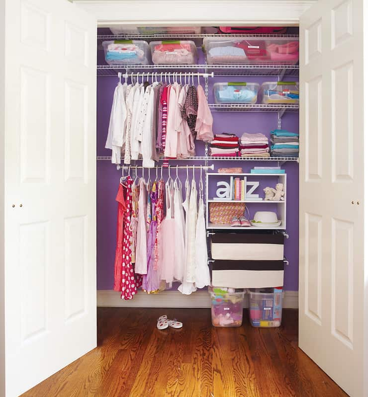 Maximize your closet space by adding a second rail to accommodate all their clothing. - How to Organize Baby Clothes | Baby Journey