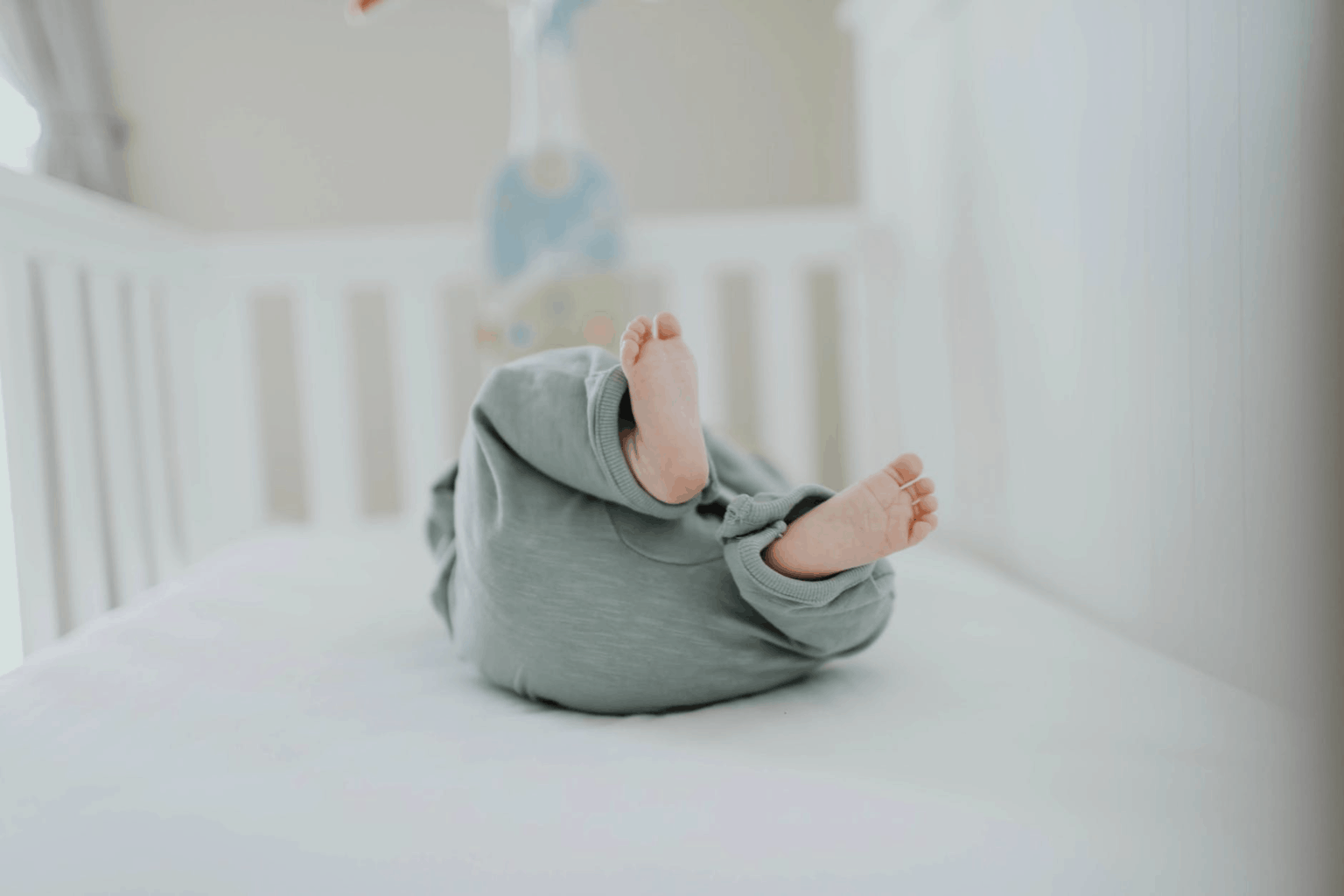 The crib is the safest sleep spot for a baby.  - Baby Sleeping in Swing - Is it Really Safe? | Baby Journey