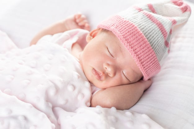 Happy adorable baby girl sleeping in crib. small kid having day ...