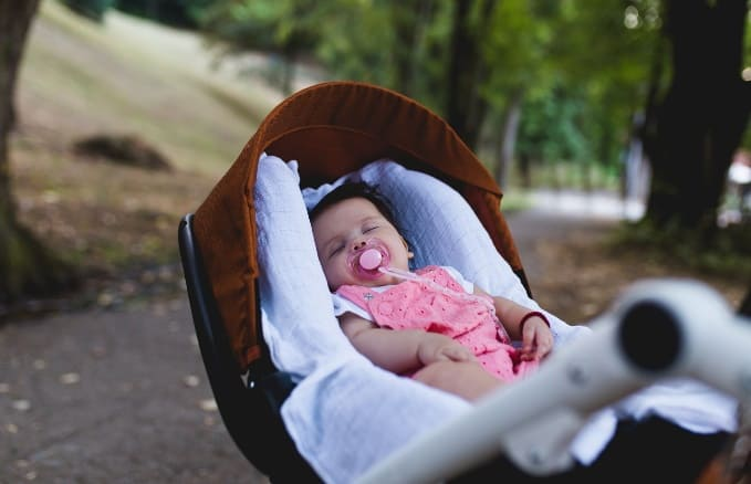 Why Your Baby Loves Sleeping In A Stroller, According To An Expert