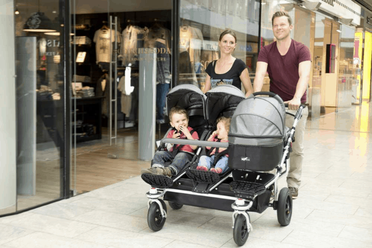 Three child family in a stroller