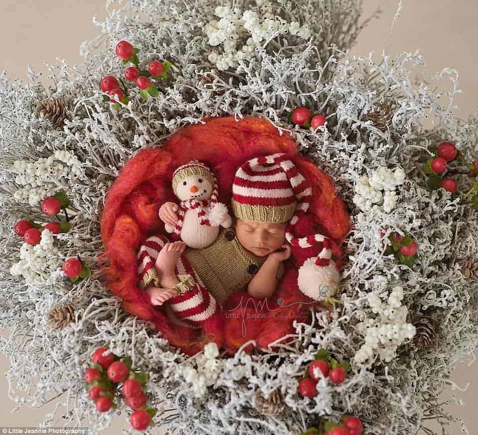 Creative newborn christmas photo Christmas wreaths come in all sizes, some even large enough to cradle a baby. Either purchase a premade wreath or create your own with fresh pine boughs and some pinecones and bows.