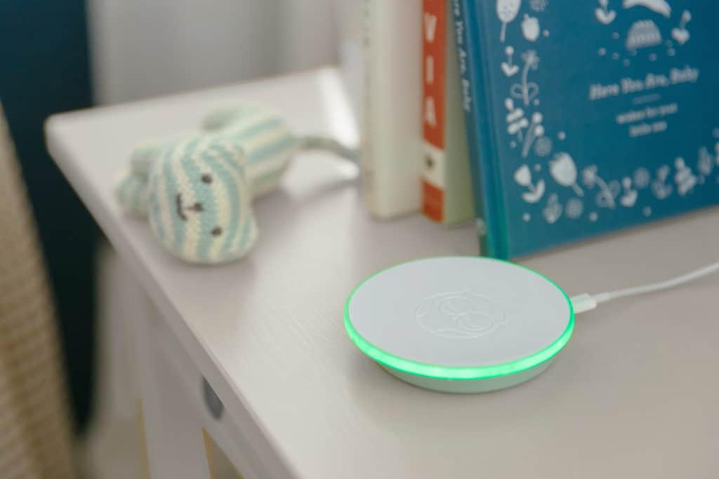 The Owlet charger cum base station alerts you with colors. Green means good! - Angelcare vs Owlet Baby Monitor Review | Baby Journey