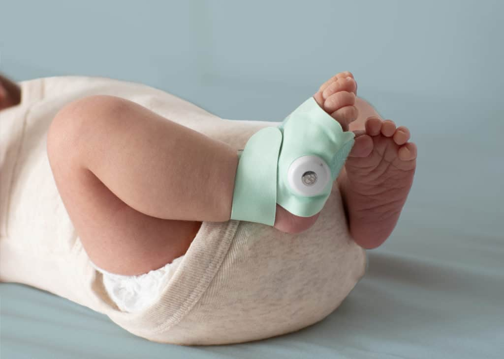 Owlet's smart sock is easily worn on the foot. - Angelcare vs Owlet Baby Monitor Review | Baby Journey