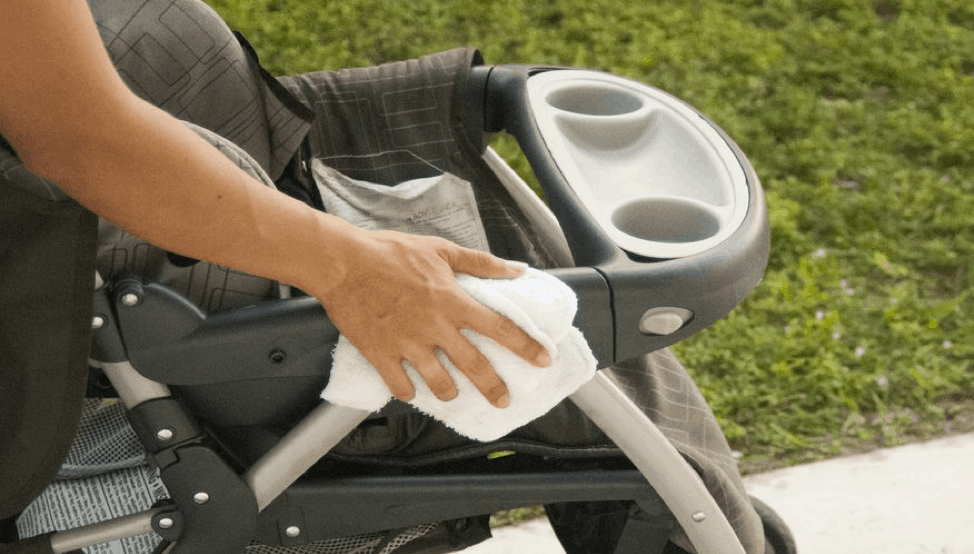 A towel is use to remove excess water while cleaning the stroller.
