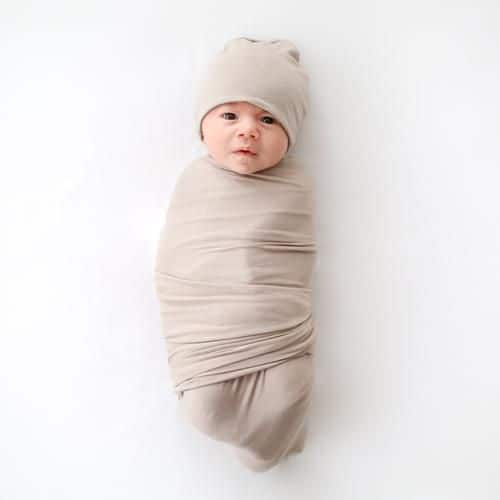 Swaddles help to keep a newborn sleep better.   - How Many Swaddles Do You Need? | Baby Journey