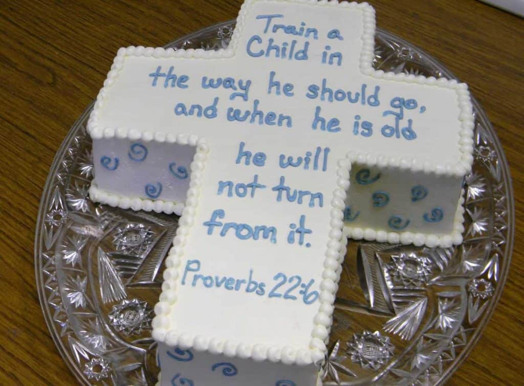 Stay within the theme of cross-shaped cake! - What to Write on Baptism Cake | Baby Journey