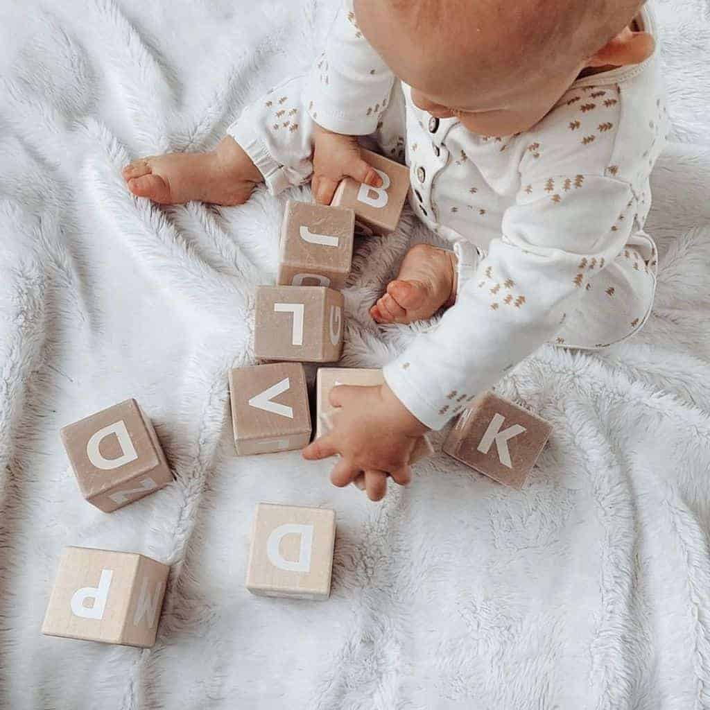 The baby will learn its first letters with the help of your baptism gift! - What Do Godparents Buy for Baptism | Baby Journey