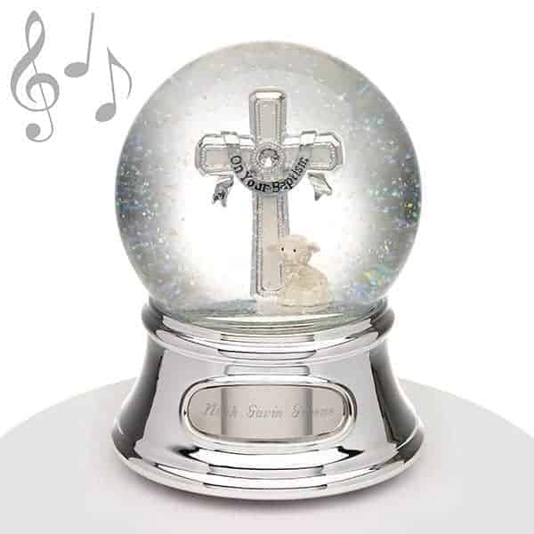 Snow globes symbolize innocence and happy childhood in modern culture. - What Do Godparents Buy for Baptism | Baby Journey