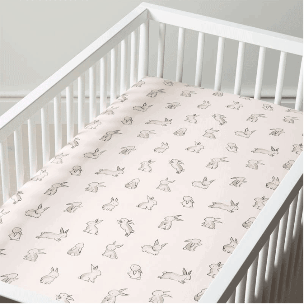 A cute, soft sheet can add comfort to your baby's crib. - How to Make Crib Mattresses Softer | Baby Journey