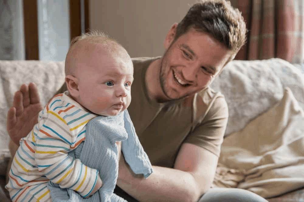 Burping in a sitting position. - How to Burp  Baby | Baby Journey