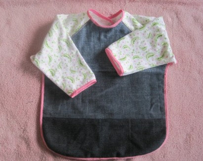 Smock bibs resemble a shirt with long sleeves, except they have an open back for easier removal.  - How Many Bibs Do I Need for my baby?   Baby Journey