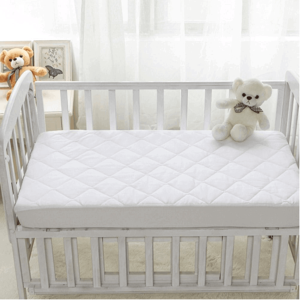 A waterproof mattress pad adds comfort as well as protection. - How to Make Crib Mattresses Softer | Baby Journey
