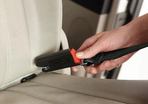 Using your knee to press down on the car seat can help loosen the straps enough to release the LATCH.- How To Fix A Stuck Car Seat | Baby Journey
