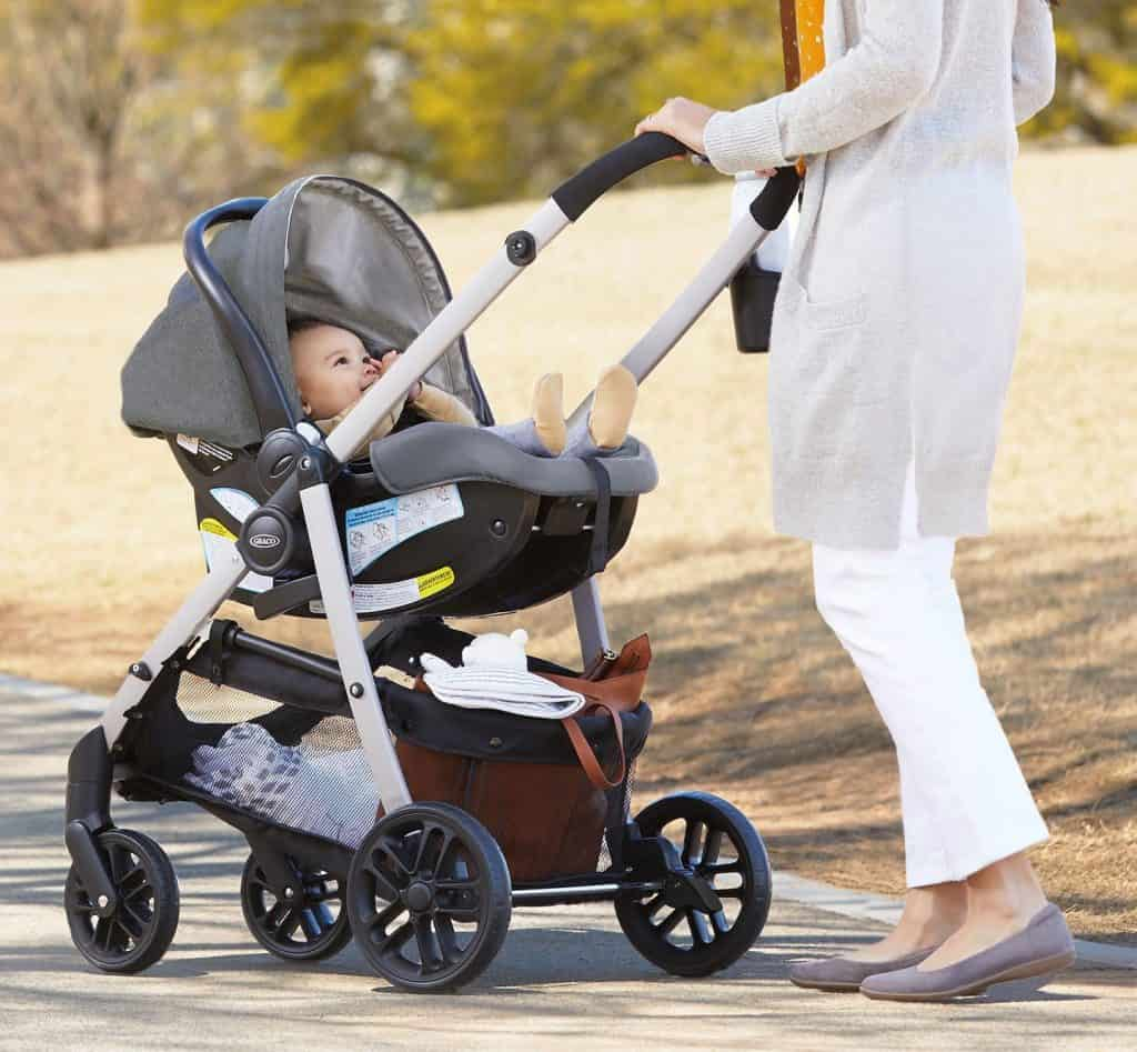 Mom strolling with baby in a Graco stroller | Best Graco Stroller Review | Baby Journey