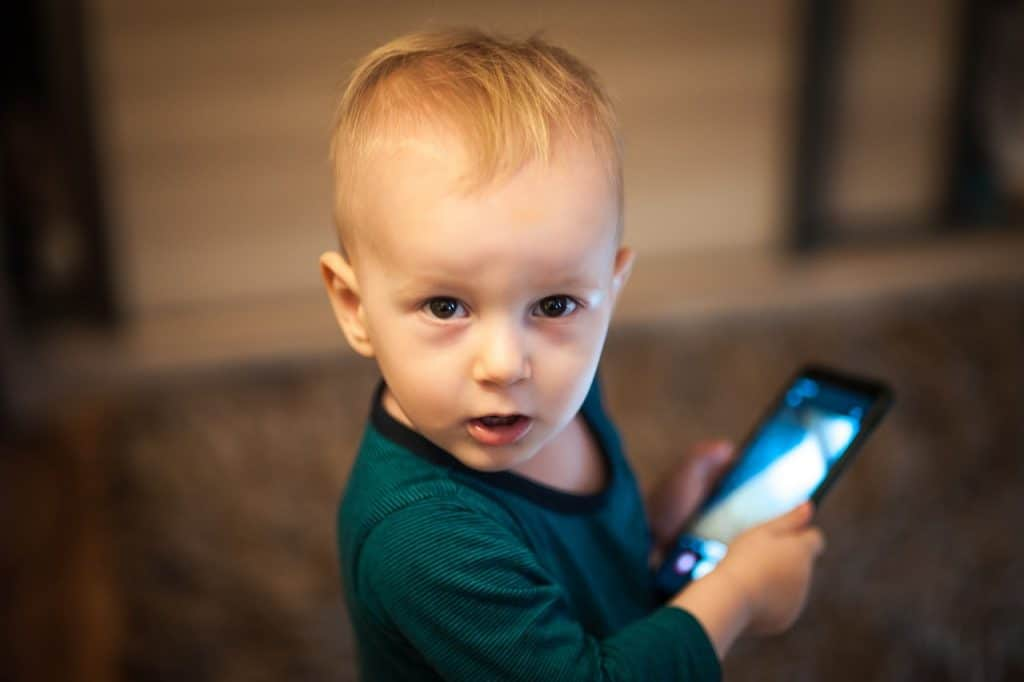 Toddlers can easily get addicted to playing with mobile devices if left unsupervised.- 9 Effective Cell Phone Rules for Younger Kids & Toddlers   Baby Journey