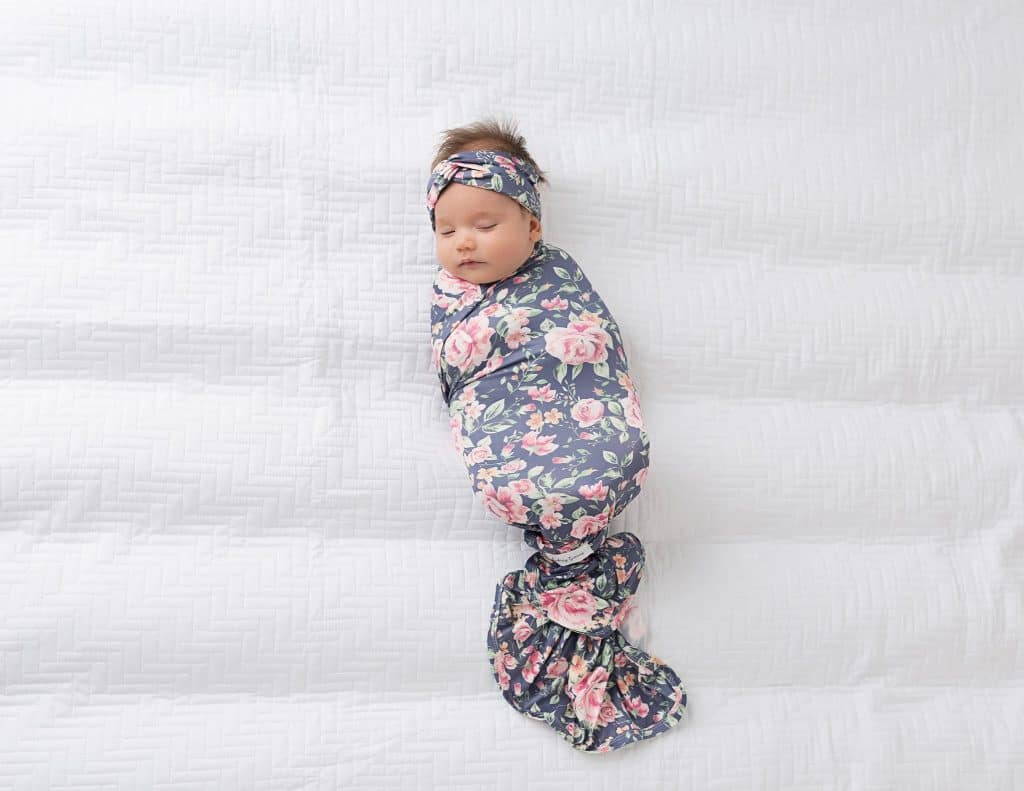 The knotted swaddle is easy and very secure.- How to swaddle a baby | Baby Journey