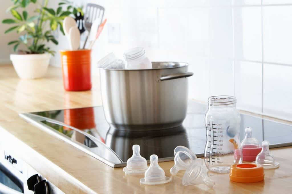 You can gently boil your baby bottle in a pot of water over the stove, but keep watch to prevent the bottle and its content from getting too hot.- How to Warm a Baby Bottle | Baby Journey