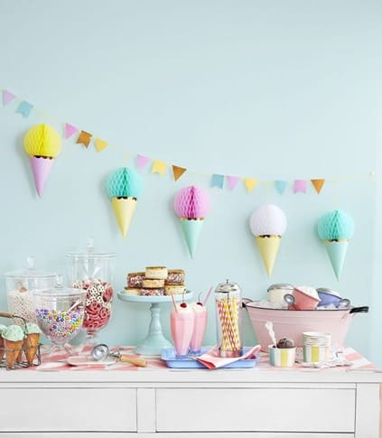 Ice cream party is an excellent idea for a summer birthday! Delicious sweets and pastel colors will make a unique atmosphere! - The Ultimate Guide to Planning Your Baby's First Birthday l Baby Journey