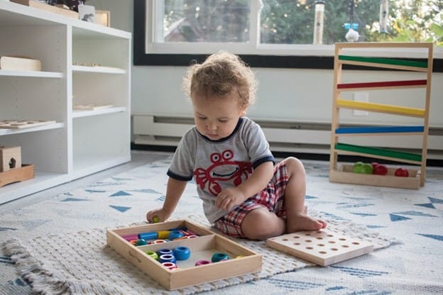Give your child plenty of open floor space for playing and movement.- How to Create a Montessori Playroom   Baby Journey