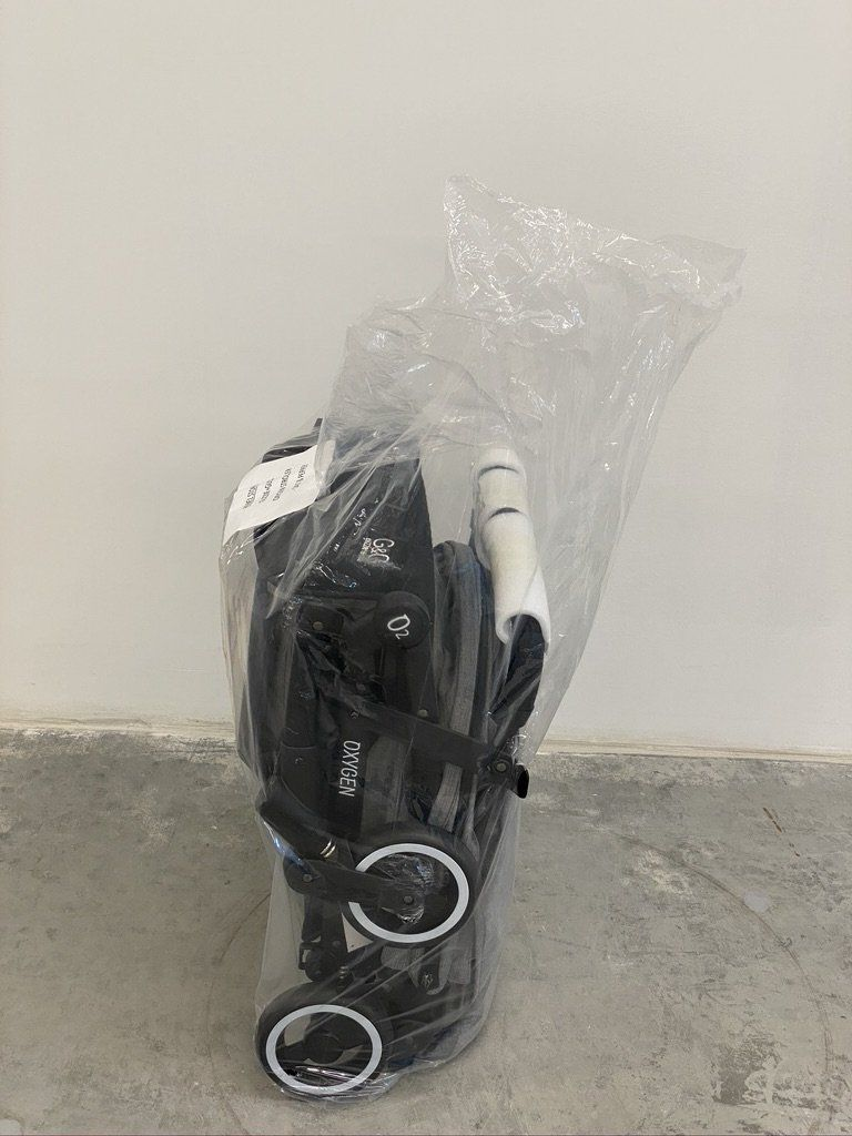 Stroller with Plastic Wrapping   How to protect stroller when flying   Baby Journey
