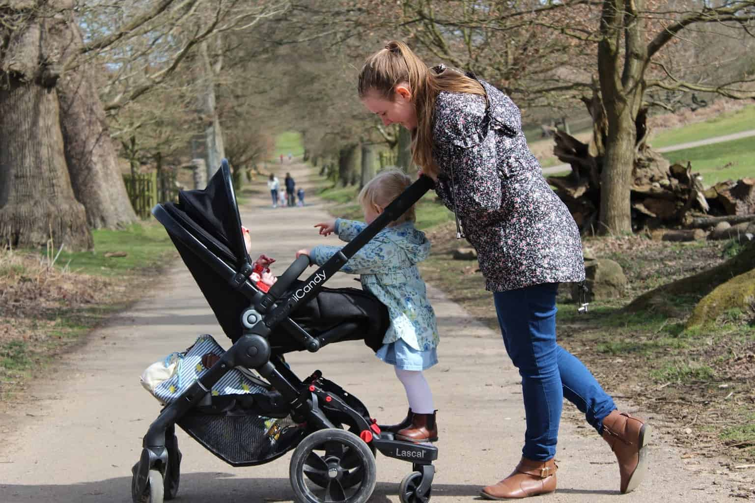 A buggy board is great for a walk in the city center as you can safely transport both children across the street. - Top 13 Parent-approved Best Stroller Accessories Ideas | Baby Journey