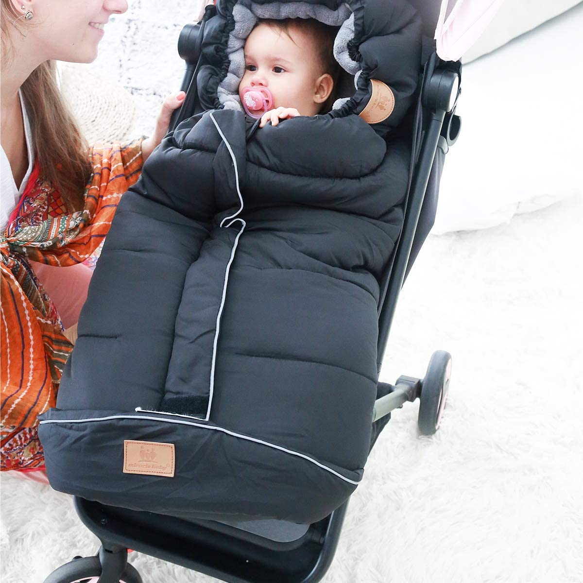 A bunting bag allows you to take your newborn outside despite the weather! - Top 13 Parent-approved Best Stroller Accessories Ideas | Baby Journey
