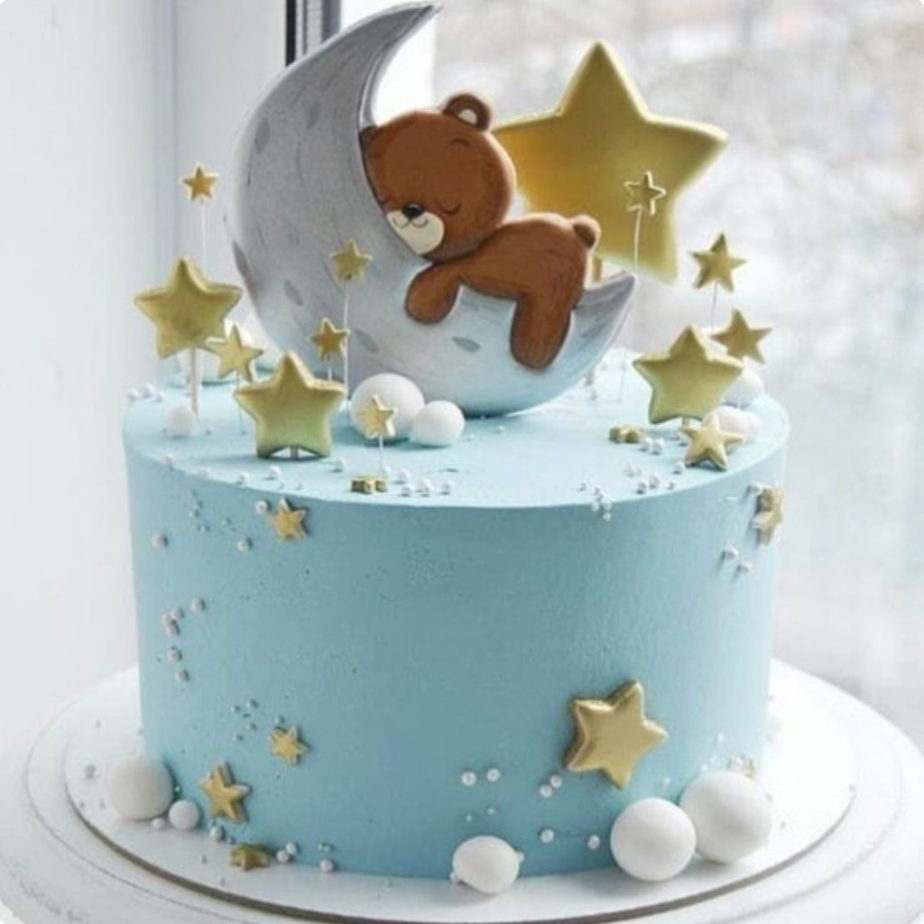 Moon and Stars Cake - 42 Unique Baby Shower Cakes and Baby Shower Cupcakes Ideas - Baby Journey Blog