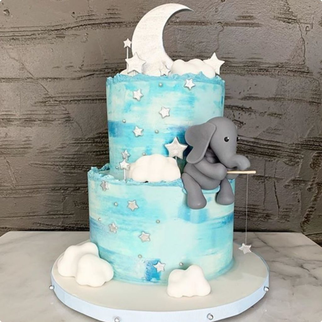 Elephant on Cake - 42 Unique Baby Shower Cakes and Baby Shower Cupcakes Ideas - Baby Journey Blog
