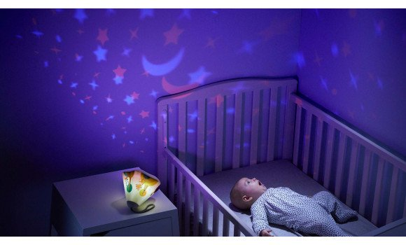 Baby staring at best crib projector soother - Best Star Projector for Babies - Best Baby Projectors to Make Wonderful Baby Light Shows - Baby Journey Blog