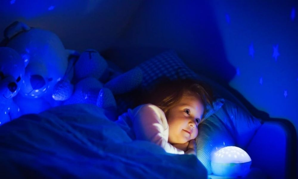 Child watching star projector - Baby Light Shows Night Light Projector - Best Baby Projectors to Make Wonderful Baby Light Shows - Baby Journey Blog