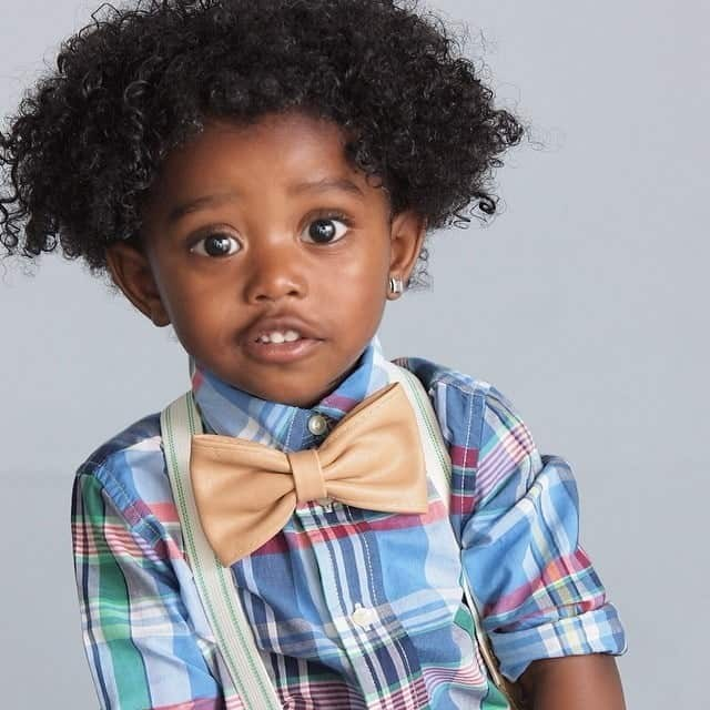 Natural Curly hairstyle. - 10 All-Time Popular Toddler Boy Haircuts | Baby Journey