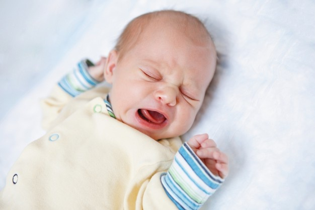 Colic could be a reason for baby's crying. - Why Babies Cry and How to Soothe Them - Baby Journey Blog