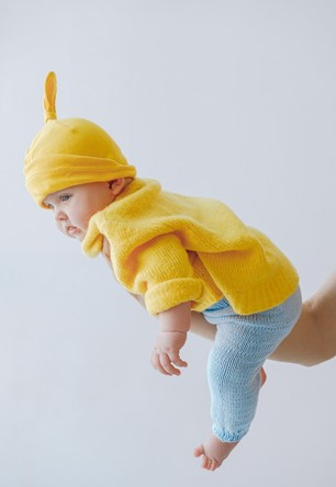 Holding baby in your arm with their belly down is one of the great tummy time alternatives - Baby Hates Tummy Time? Here Are 9 Best Alternatives to Tummy Time - Baby Journey blog