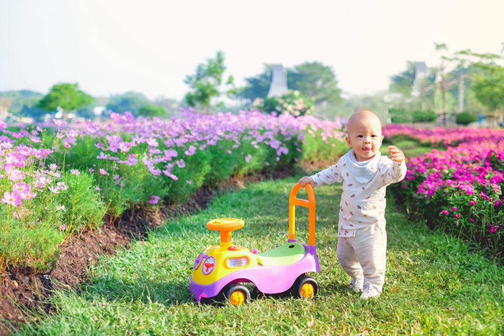Baby using push walker in garden   Best Baby Push Walker   Baby Journey
