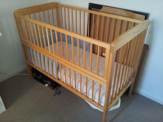 Abide by current safety standards banning drop side rail cribs. - When To Lower Crib Mattress? An Easy Guide to Understanding Your Baby's Crib Setting - Baby Journey blog