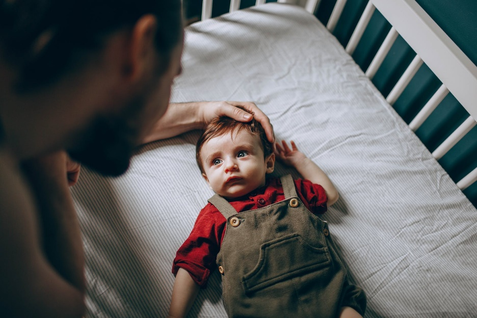 Laying your child down drowsy but awake is ideal if you're a short parent trying to lower them into a low crib.   - When To Lower Crib Mattress? An Easy Guide to Understanding Your Baby's Crib Setting - Baby Journey blog