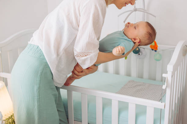 You should put your baby to sleep in the crib on their back. - When To Lower Crib Mattress? An Easy Guide to Understanding Your Baby's Crib Setting - Baby Journey blog